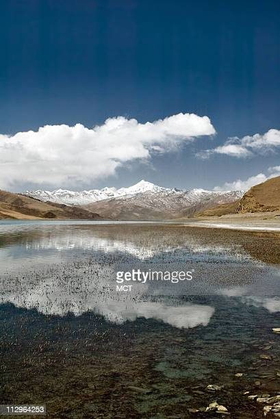 """Glaciers on the Tibetan Plateau. High-altitude Tibet is known as the """"rooftop of the world,"""" but lately the roof is a bit saggy. Global warming is..."""