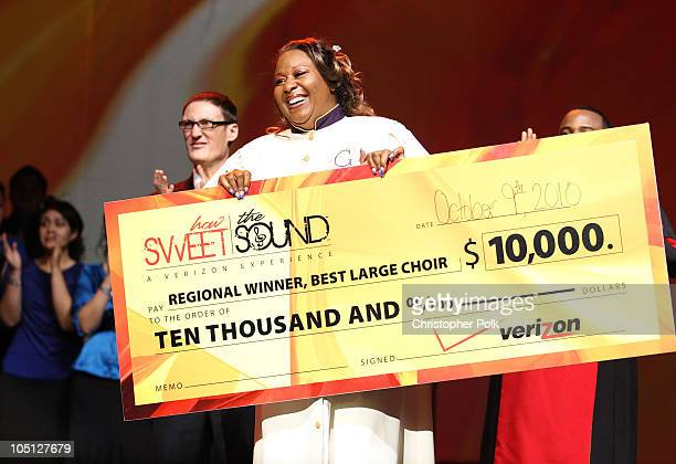 Glad Tidings Mass Choir is presented with a check for Best Large Choir and is voted Best Overall Regional Choir onstage during Verizon's How Sweet...