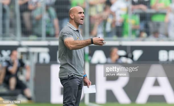 Gladbach's head coach Andre Schubert gestures during the German Bundesliga soccer match between Borussia Moenchengladbach and FC Ingolstadt 04 in...