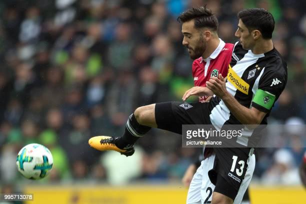 Gladbach's Lars Stindl and Hanover's Kenan Karaman vie for the ball during the German Bundesliga match between Borussia Moenchengladbach and Hanover...