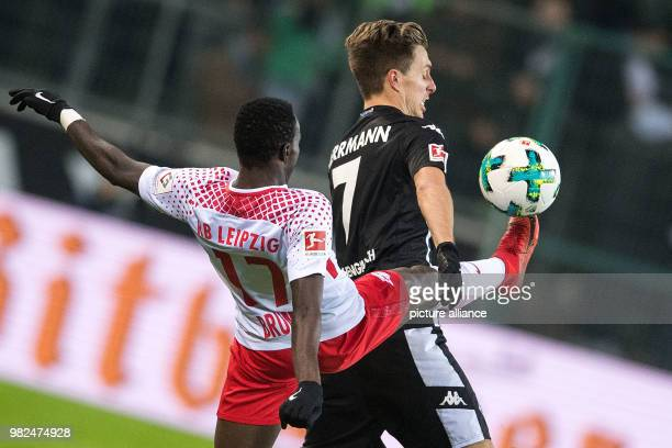 Gladbach's Patrick Herrmann and Leipzig's Bruma vie for the ball during the German Bundesliga football match between Borussia Moenchengladbach and RB...