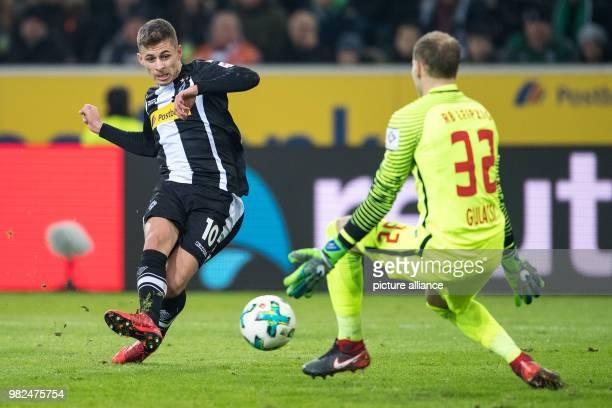 Gladbach's Thorgan Hazard is offside against Leipzig goalie Peter Gulacsi during the German Bundesliga football match between Borussia...