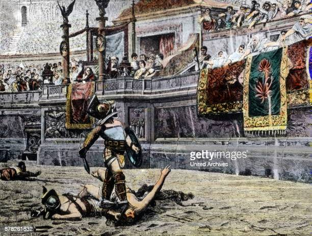 A gladiator waiting for the decision of emperor and people over his victim at the Colosseum at Rome Italy