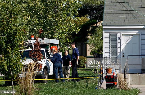Gladstone police investigate a crime scene on September 19 in Gladstone Missouri Authorities found Kevin M Mashburn unconscious inside his truck just...
