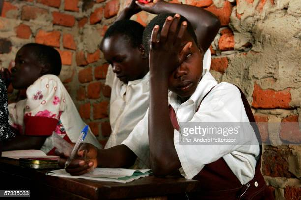 Gladys Aromo age 12 tries to stay awake at a period at St Martine Primary School on May 27 2005 in Laliya Uganda Gladys is a night commuter one of...