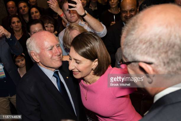 Gladys Berejiklian is greeted by former PM John Howard and current PM Scott Morrison at the Sofitel Wentworth on March 23 2019 in Sydney Australia...
