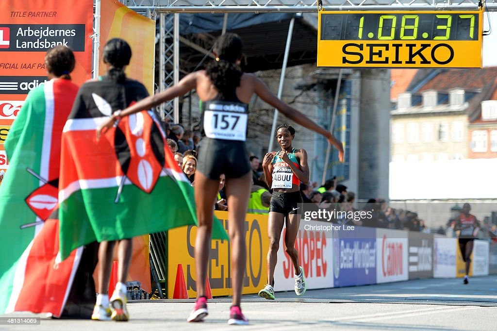 Gladys Cherono, Mary Wacera Ngugi and Selly Chepyego Kaptich of Kenya wait for teammate Lucy Wangui Kabuu at the finish line during the IAAF/Al-Bank World Half Marathon Championships on March 29, 2014 in Copenhagen, Denmark.