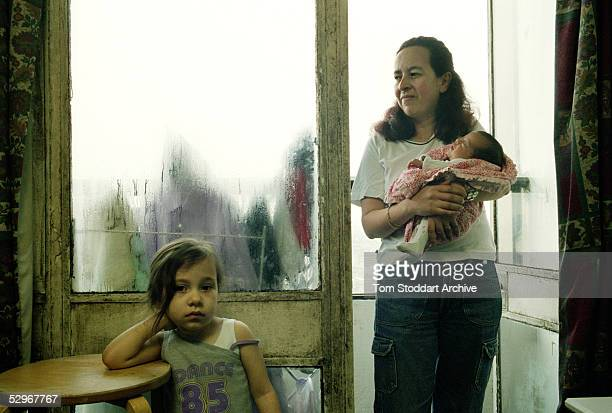 Gladys Cortina and and her two daughters Valentina 3years old and Luisa aged 3months in the family home on the 24th floor of the Mallard Point tower...