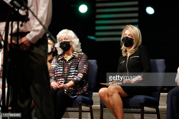 Gladys Cross left exwife of Don Lewis and his daughter Donna Pettis share the stage during a news conference at Riverhills Church of God on August 10...