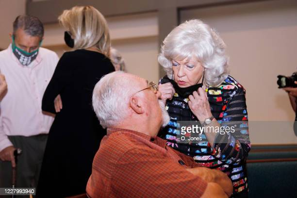 Gladys Cross the exwife of Don Lewis speaks to a family friend after a news conference at Riverhills Church of God on August 10 2020 in Tampa Florida...