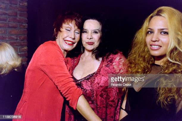 Gladys del Valle Rojo 'Gogó Rojo' Castro and Argentine actress Isabel Sarli attends the 'Gogó' inauguration party on March 23 2004 in Buenos Aires...