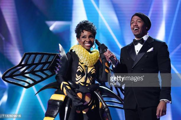 Gladys Knight and host Nick Cannon in the special twohour Road to the Finals / Season Finale The Final Mask is Lifted season finale episode of THE...
