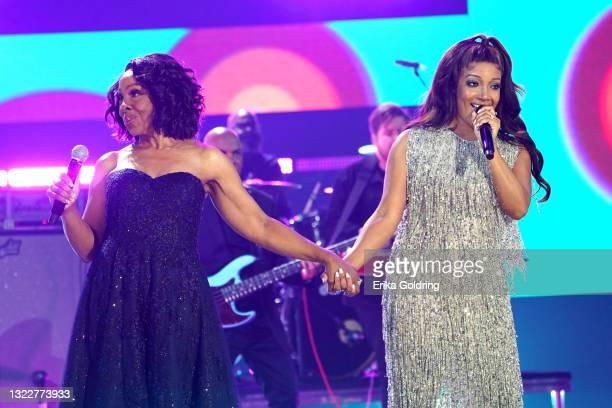 Gladys Knight and Mickey Guyton perform onstage for the 2021 CMT Music Awards at Bridgestone Arena on June 09, 2021 in Nashville, Tennessee.