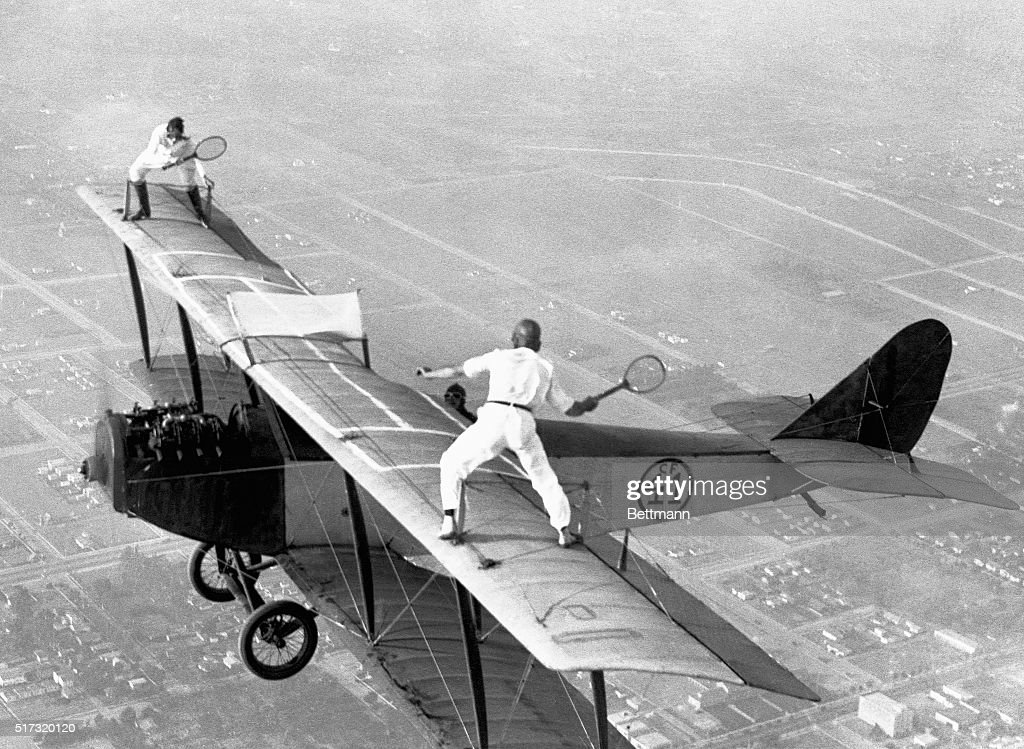 Gladys Roy, who gets her fun out of doing unusual things with airplanes, also likes to play tennis. Ivan Unger (member of the 'Flying Black Hats') is her opponent. Frank Tomac is the pilot who keeps the plane at 3,000 feet. The only problem with this match is trying to retrieve a ball after it has bounced off the wing of the plane and plunged a few thousand feet.