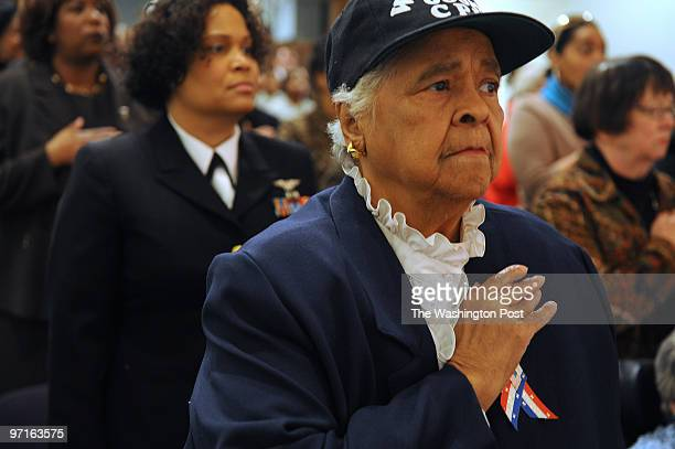 Gladys Schuster Carter stands for the National Anthem during a Black History Month Program Honoring the Legacy of the 6888th Central Postal Directory...
