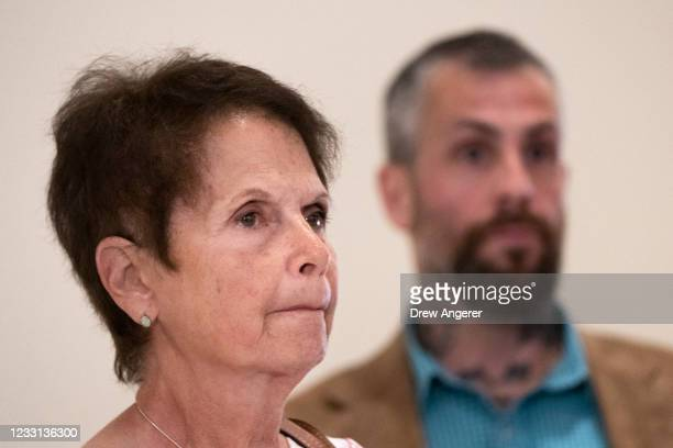Gladys Sicknick, the mother of late Capitol Police Officer Brian Sicknick and Metropolitan Police Officer Michael Fanone speak to the press as they...