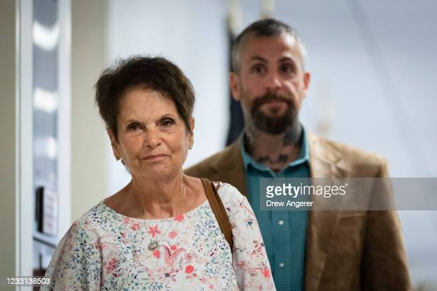 Gladys Sicknick, the mother of late Capitol Police Officer Brian Sicknick, and DC Metropolitan Police OfficerMichael Fanone arrive for a meeting...