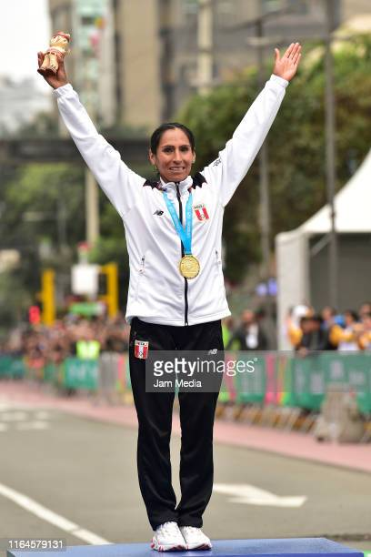 Gladys Tejeda of Peru celebrates with her gold medal after the women's marathon final at Parque Kennedy on July 27 2019 in Lima Peru