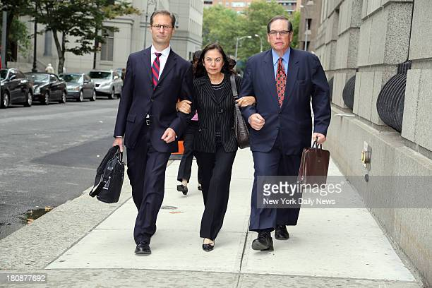 Glafria Rosales leaves Manhattan Federal Court with her lawyers after pleading guilty to selling over 60 works of fake art to two Manhattan galleries