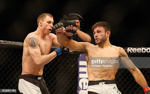 Glaico Franca elbows James Vick in their lightweight bout during the UFC 197 event inside MGM Grand Garden Arena on April 23 2016 in Las Vegas Nevada
