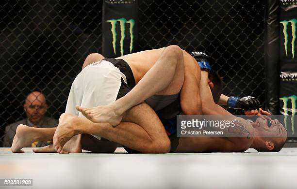 Glaico Franca grapples with James Vick in their lightweight bout during the UFC 197 event inside MGM Grand Garden Arena on April 23 2016 in Las Vegas...