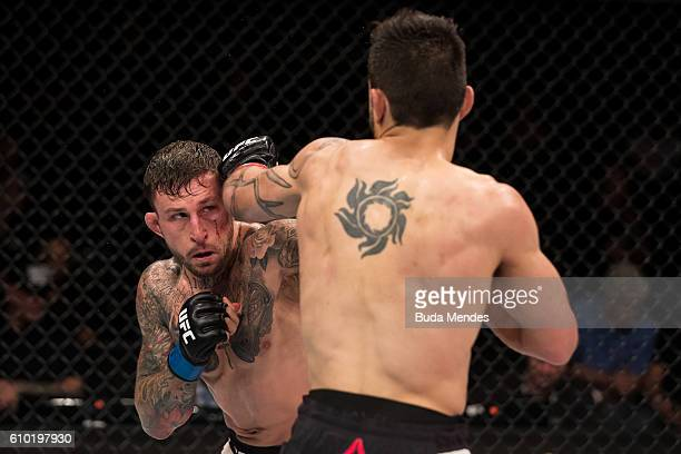 Glaico Franca of Brazil punches Gregor Gillespie of the United States in their lightweight UFC bout during the UFC Fight Night event at Nilson Nelson...