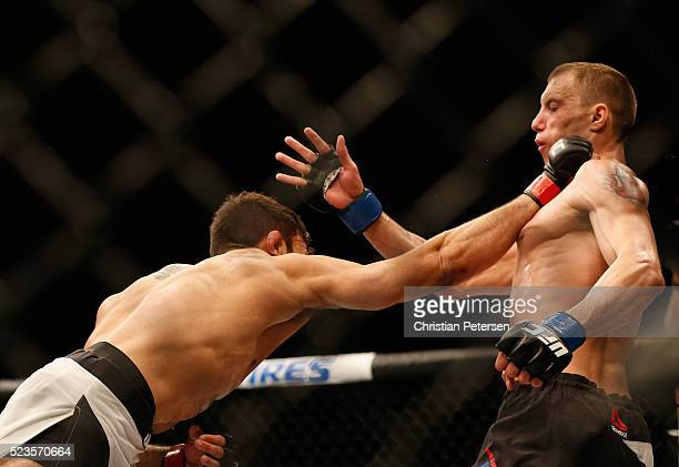 Glaico Franca punches James Vick in their lightweight bout during the UFC 197 event inside MGM Grand Garden Arena on April 23 2016 in Las Vegas Nevada