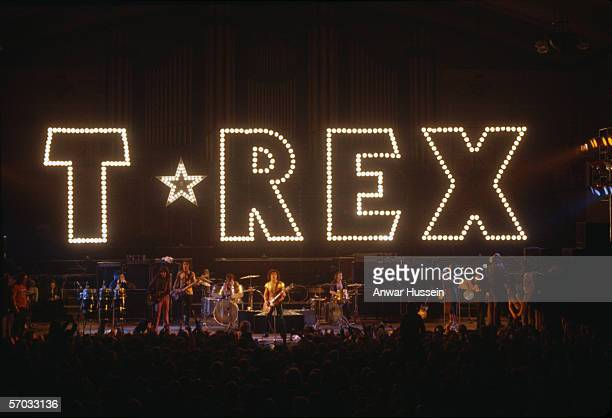 Glam rock group TRex perform with their name in lights above the stage circa 1975