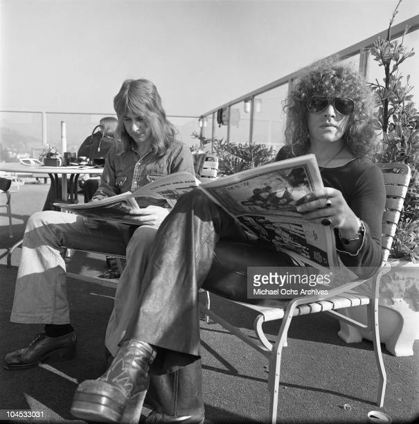 Glam rockers Ian Hunter and Mick Ralphs of Mott The Hoople pose for a photo by the rooftop pool of The Continental Hyatt House or Riot Hyatt on...