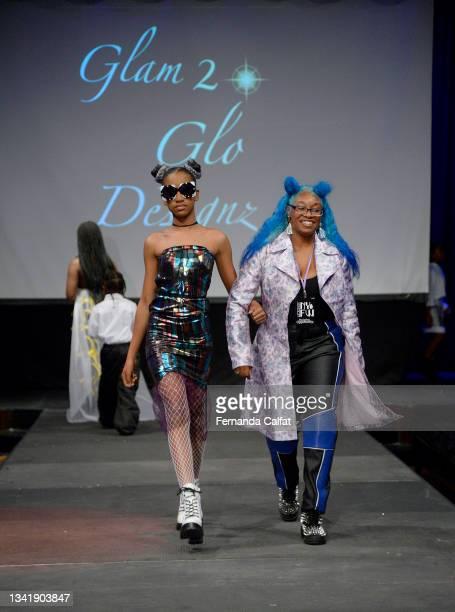 Glam2Glo Designz designer on the runway with a model at NYFW hiTechMODA Season 6 at The Edison Ballroom on September 12, 2021 in New York City.