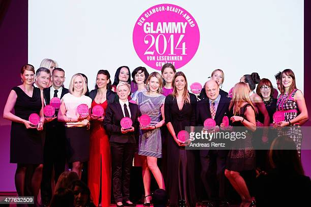 Glammy winners pose with their awards during the Glammy Award by Glamour Magazine on March 6, 2014 in Munich, Germany.