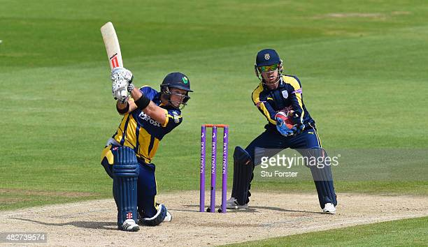 Glamorgan batsman Colin Ingram hits out during his half century watched by Hampshire wicketkeeper Adam Wheater during the Royal London OneDay Cup...
