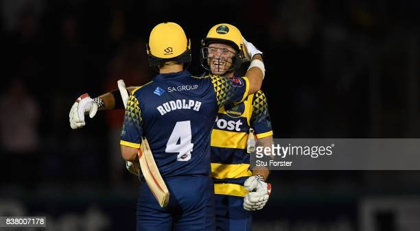 Glamorgan batsmen Jacques Rudolph and Colin Ingram celebrate victory after the NatWest T20 Blast QuarterFinal match between Glamorgan and...