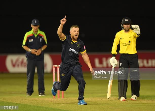Glamorgan bowler Graham Wagg celebrates after taking the wicket of batsman Cockbain during the T20 Vitality Blast game between Glamorgan and...