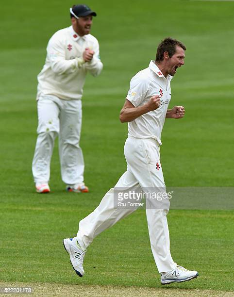 Glamorgan bowler Michael Hogan celebrates after taking the wicket of Angus Robson during day two of the Specsavers second division County...
