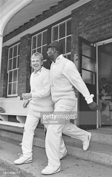 Glamorgan captain Hugh Morris and Viv Richards share a joke as they come out of the pavilion to field during a Benson & Hedges Cup match between...