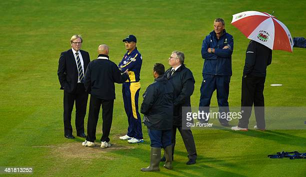 Glamorgan captain Jacques Rudolph discusses prospects of play with chief executive Hugh Morris and umpire Jeffrey Evans as play is delayed during the...