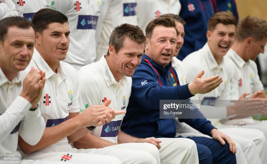 Glamorgan captain Michael Hogan (3rd l) and head coach Robert Croft (c) share a joke during the 2018 Glamorgan CCC photocall at SSE Swalec Stadium on April 17, 2018 in Cardiff, Wales.