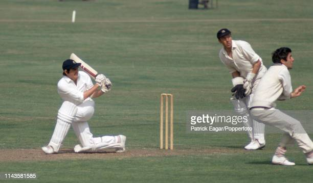 Glamorgan captain Tony Lewis sweeps the ball past Middlesex fielders John Murray and Mike Brearley while batting in the County Championship match...