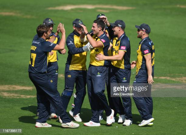 Glamorgan celebrate the wicket of Aaron Finch of Surrey during the Vitality Blast match between Glamorgan and Surrey at Sophia Gardens on August 11,...