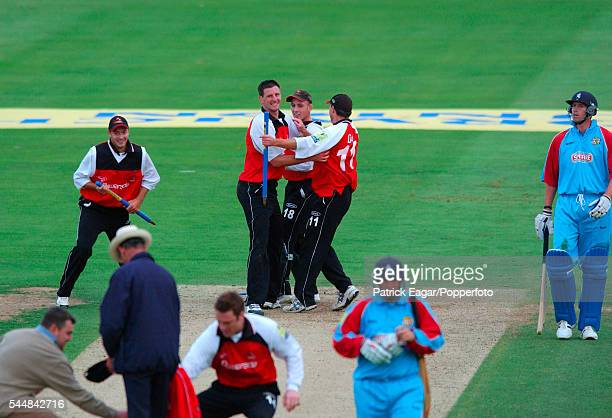 Glamorgan Dragons players celebrate winning the Norwich Union League Division 1 after beating Kent Spitfires at Canterbury Kent 15th September 2002