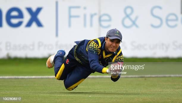 Glamorgan fielder Kiran Carlson takes a diving catch to dismiss Somerset batsman Johann Myburgh during the Vitality Blast match between Glamorgan and...