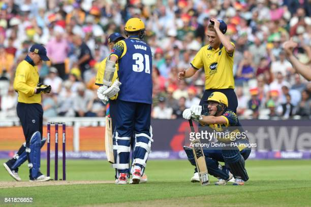 Glamorgan's Andrew Salter appears dejected as Birmingham's Chris Woakes celebrates taking the final wicket during the NatWest T20 Blast Finals Day at...
