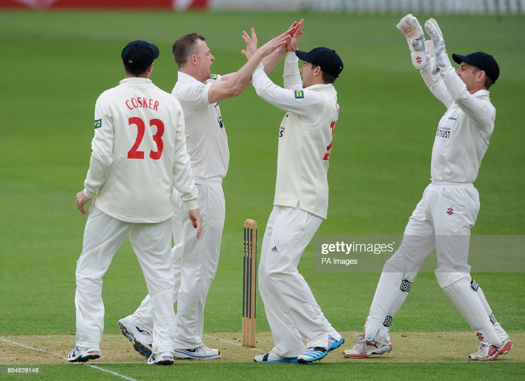 Glamorgan's Graham Wagg celebrates with Chris Cooke after