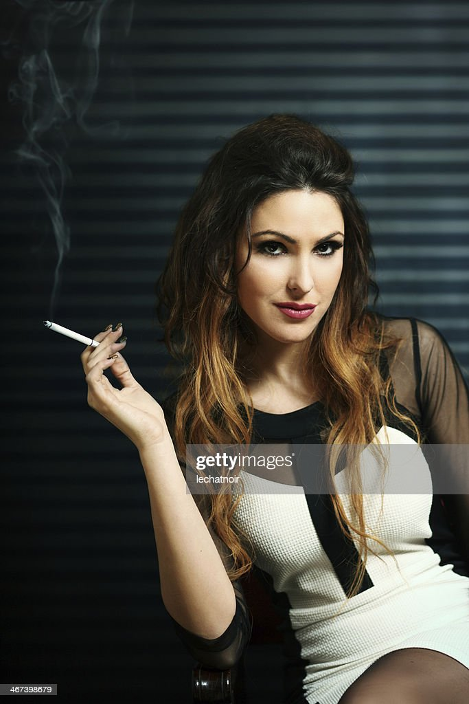 https://media.gettyimages.com/photos/glamorous-brunette-with-a-cigarette-picture-id467398679