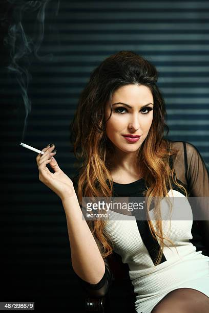 glamorous brunette with a cigarette - beautiful women smoking cigarettes stock photos and pictures