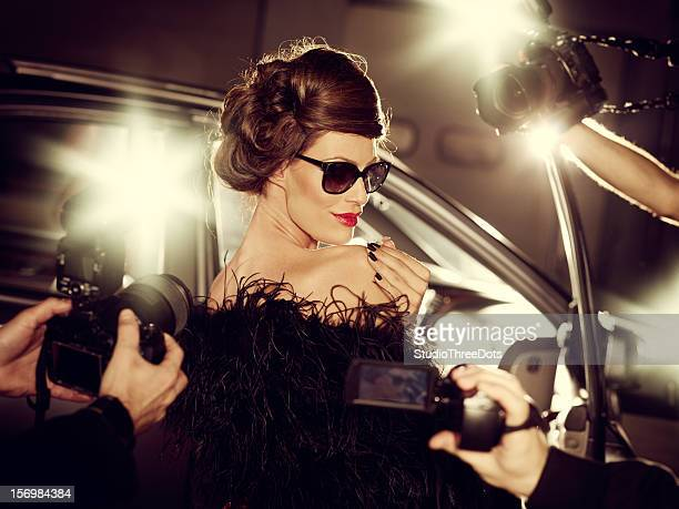 glamorous celebrity woman surrounded by paparazzi photographers - celebrities photos stock pictures, royalty-free photos & images
