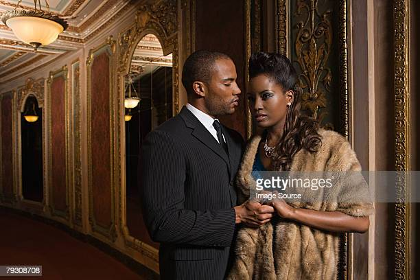 a glamorous couple - fur coat stock pictures, royalty-free photos & images