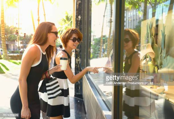 Glamorous friends window shopping