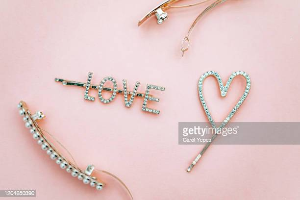 glamorous golden hairpins in pink - wedding background stock pictures, royalty-free photos & images